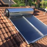 Solarhart hot water system with tank and two panels on roof