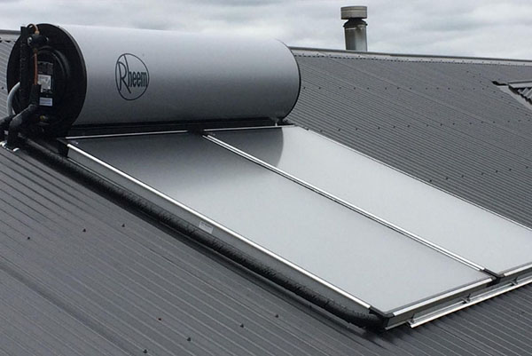 Rheem solar hot water tank with two panels installed on roof