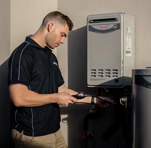 Aquatek plumber working on Rheem gas continuous flow hot water service