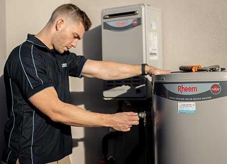 Aquatek plumber repairs Rheem electric solar hot water tank