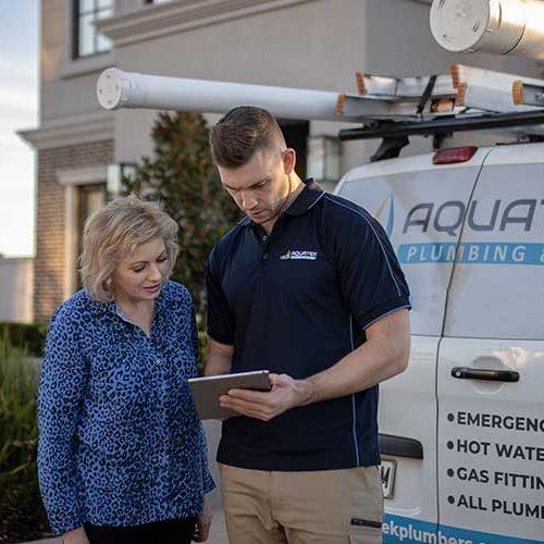 Aquatek plumber present plumbing products to a customer